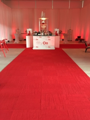 Gensler red carpet and plexi bar with logo and back bar shelf